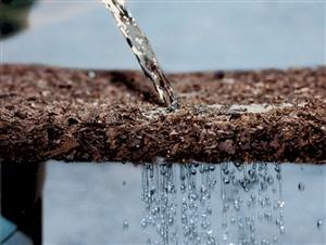 Water allows tto pass through rubber mulch